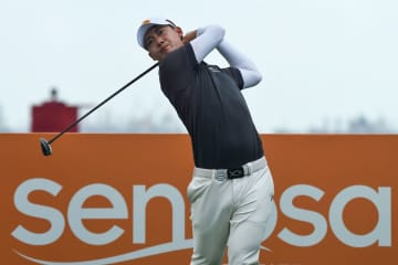 Defending champion Jazz Janewattananond of Thailand hits a shot during the third round of the Singapore Open at the Sentosa Golf Club on Saturday. (AFP Photo)