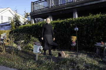 Elaine Scattergood stands in front of the vines growing on her home in Avalon, in this Jan. 17, 2020 photo. (Kristian Gonyea/)