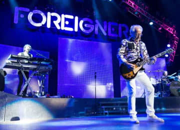 NEWARK, NJ - JUNE 26: Mick Jones of the group Foreigner performs at Prudential Center on June 26, 2014 in Newark, New Jersey. (Photo by Dave Kotinsky/Getty Images)