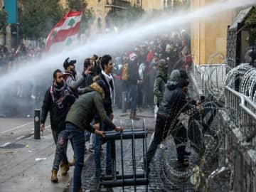 Beirut in chaos as riot police use water canons to disperse Lebanon protesters