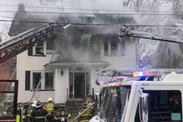 Firefighters on Jan. 18, 2020 battle a blaze at a two story home in Nutley. (Michael Diacheysn /)