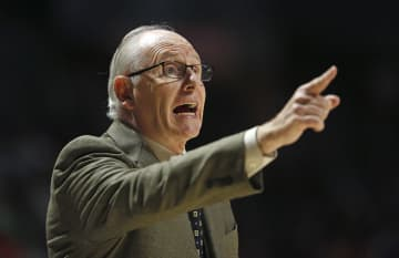 On February 6, 2019, Miami head coach Jim Larranaga gives instructions to his team against Notre Dame at the Watsco Center in Coral Gables, Fla. - DAVID SANTIAGO/Miami Herald/TNS