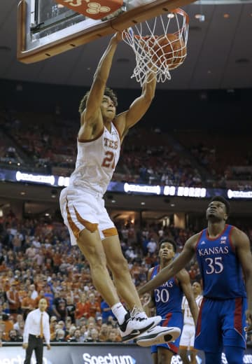 Jericho Sims #20 of the Texas Longhorns dunks the ball against the Kansas Jayhawks at The Frank Erwin Center on January 18, 2020 in Austin, Texas. - Chris Covatta/Getty Images North America/TNS