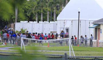 Children are seen at the Homestead shelter for migrant children in Homestead, Fla., on June 23, 2018. - Al Diaz/Miami Herald/TNS