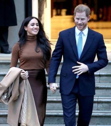英王室のヘンリー王子(右)と妻メーガン妃(ゲッティ=共同)