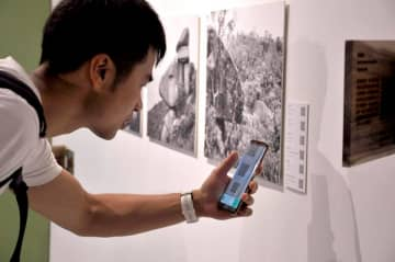A visitor interacts with an exhibit at the Hike and Seek exhibition. Photo: Linus Kwok/TrailWatch.