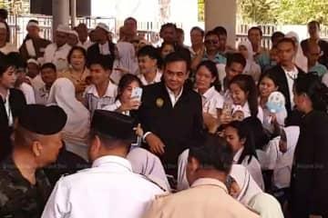 Prime Minister Prayut Chan-o-cha meets students during his visit to Narathiwat province on Monday. (Photo by Mongkol Bangprapa)