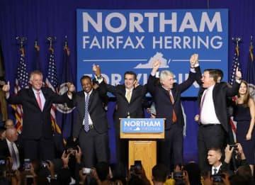 FAIRFAX, VA - NOVEMBER 07: Gov.-elect Ralph Northam (C) links arms with (L-R) current Gov. Terry McAuliffe, Lt. Gov.-elect Justin Fairfax, Attorney General-elect Mark Herring, and U.S. Sen. Mark Warner (D-VA) at an election night rally November...