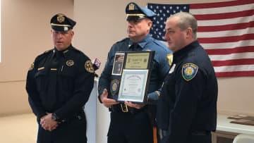 President of the NJ Police K9 Association, Ken Sacavitch rewards Firefighter Tyler Van Leer with a certificate of completion for K9 Hansel. (Mackenzie Fitchett/)