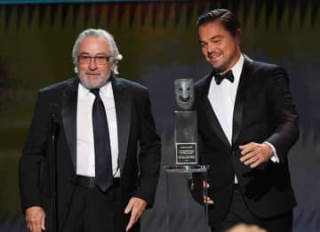 LOS ANGELES, CALIFORNIA - JANUARY 19: (L-R) Robert De Niro accepts the Screen Actors Guild Life Achievement Award from Leonardo DiCaprio onstage during the 26th Annual Screen Actors Guild Awards at The Shrine Auditorium on January 19, 2020 in...