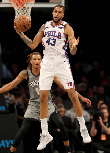 Jonah Bolden (43) of the Philadelphia 76ers grabs the pass as Nicolas Claxton (33) of the Brooklyn Nets defends in the first half on Monday, Jan. 20, 2020 at Barclays Center in New York City. - Elsa/Getty Images North America/TNS