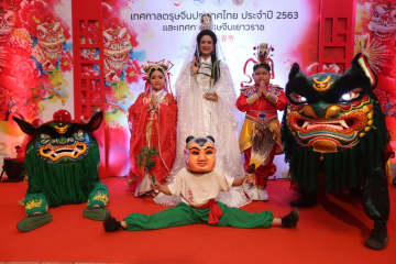 Performers are ready for the celebration on Yaowarat Road. Photos: Varuth Hirunyatheb