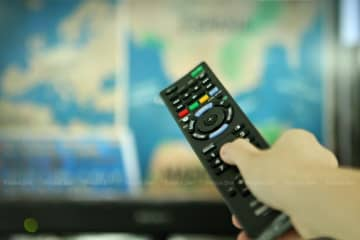 Digital TV operators are urged to adjust their business models to cope with the prospect of declining ad spending on TV this year and challenges from over-the-top platforms. (Bangkok Post photo)