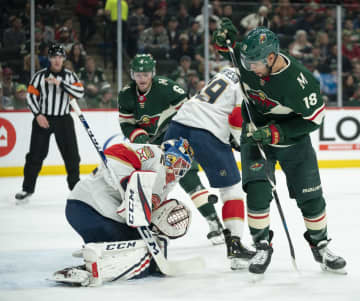A puck bounces in front of Florida Panthers goaltender Sergei Bobrovsky (72) and Minnesota Wild left wing Jordan Greenway (18) in the second period Monday, Jan. 20, 2020 at Xcel Energy Center in St. Paul. - Jeff Wheeler/Minneapolis Star Tribune/TNS