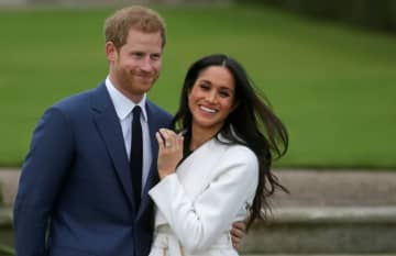 Britain's Prince Harry and Meghan Markle are bowing out entirely from representing the monarchy. (AFP photo)
