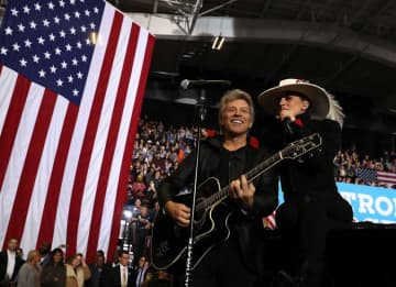 Musicians Jon Bon Jovi (L) and Lady Gaga perform during a campaign rally with Democratic presidential nominee former Secretary of State Hillary Clinton at North Carolina State University on November 8, 2016 in Raleigh, North Carolina. The...