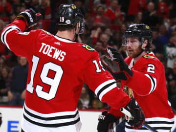 Blackhawks center Jonathan Toews and defenseman Duncan Keith celebrate after a goal against the Capitals on Feb. 17, 2017, at the United Center. - Nuccio DiNuzzo / Chicago Tribune/Chicago Tribune/TNS