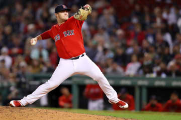 Travis Lakins #56 of the Boston Red Sox pitches during the eighth inning of the game between the Boston Red Sox and the New York Yankees at Fenway Park on September 09, 2019 in Boston, Massachusetts. - Maddie Meyer/Getty Images North America/TNS