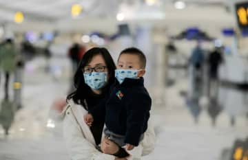 Airport health screenings have been stepped up across China and Asia, including at Beijing's Daxing airport, seen here — in the US, five international airports will now check passengers arriving from the Chinese city of Wuhan.