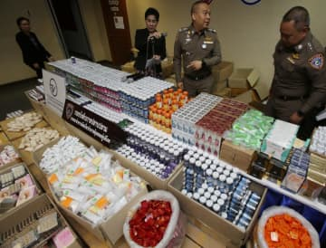 Police display more than 15,000 items of seized counterfeit herbal medicines, cosmetics and supplementary foods at a press briefing at the Consumer Protection Police Division in Bangkok on Tuesday.Apichit Jinakul