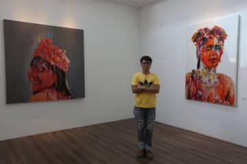 Thinnapat Takuear and his first solo exhibition, 'Reflection Of Desire'.  Photos: Varuth Hirunyatheb