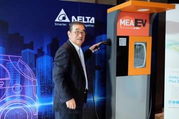Mr Shen-yen with an AC EV charger for home use. Delta's AC chargers are priced 50,000-80,000 baht.