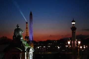General view of the Eiffel Tower and the Luxor Obelisk on Place de la Concorde in Paris. France reported 11% increase in international tourism spending last year.(AFP photo)