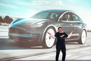 Tesla CEO Elon Musk gestures during the Tesla China-made Model 3 delivery ceremony in Shanghai on January 7.