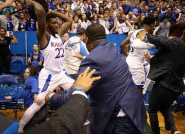 LAWRENCE, KANSAS - JANUARY 21: Silvio De Sousa #22 of the Kansas Jayhawks picks up a chair during a brawl as the game against the Kansas State Wildcats ends at Allen Fieldhouse on January 21, 2020 in Lawrence, Kansas.