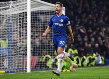 LONDON, ENGLAND - JANUARY 21: Cesar Azpilicueta of Chelsea celebrates after scoring his team's second goal as Bernd Leno of Arsenal reacts during the Premier League match between Chelsea FC and Arsenal FC at Stamford Bridge on January 21, 2020...