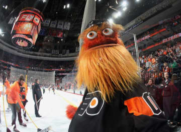 Gritty celebrates a Flyers goal against the Boston Bruins at the Wells Fargo Center on Jan. 16, 2019. (BRUCE BENNETT/)