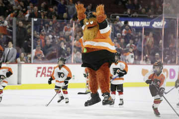 Philadelphia Flyers mascot Gritty celebrates his goal in between periods during the Arizona Coyotes vs. Philadelphia Flyers NHL game at the Wells Fargo Center in Philadelphia on Nov. 8, 2018. - ELIZABETH ROBERTSON/The Philadelphia Inquirer/TNS