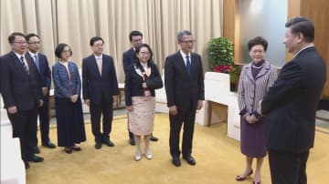 Carrie Lam and Hong Kong top officials met Xi Jinping in Macau. Photo: GovHK.