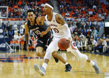 Auburn's Samir Doughty, right, drives against South Carolina's Justin Minaya during the first half at Auburn Arena in Auburn, Ala., on Wednesday, Jan. 22, 2020. Auburn won, 80-67. - Todd Kirkland/Getty Images North America/TNS