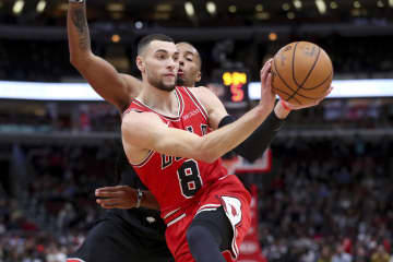 Zach LaVine makes a move around the Raptors' Norman Powell on Monday, Dec. 9, 2019 at the United Center. - Armando L. Sanchez / Chicago Tribune/Chicago Tribune/TNS