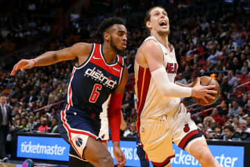 The Miami Heat's Kelly Olynyk, right, drives against the Washington Wizards' Troy Brown Jr. (6) in the second quarter at the AmericanAirlines Arena in Miami on Wednesday, Jan. 22, 2020. - DAVID SANTIAGO/Miami Herald/TNS