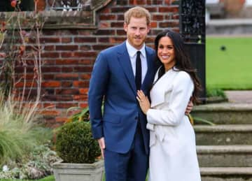 Prince Harry and Meghan Markle attend a photo call at Kensington Palace to mark their engagement