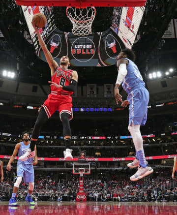 The Chicago Bulls' Zach LaVine (8) drives to the basket past the Minnesota Timberwolves' Robert Covington (33) at the United Center in Chicago on Wednesday, Jan. 22, 2020. The Bulls won, 117-110. - Jonathan Daniel/Getty Images North America/TNS