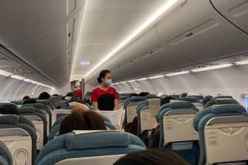 A Cathay Dragon attendant wears a mask on a flight to Wuhan in China. (South China Morning Post photo)