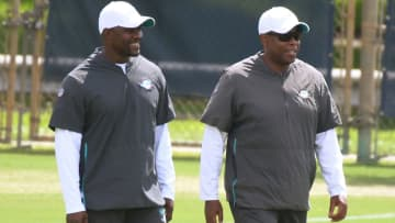 Dolphins coach Brian Flores, left, and general manager Chris Grier on the field during training camp on Aug. 19, 2019. - Joe Cavaretta/Sun Sentinel/TNS