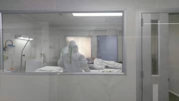The fourth coronavirus patient in an isolation ward at Nakhon Pathom Hospital on Tuesday. The fifth case detected in Thailand was confirmed in Bangkok on Friday – a Chinese tourist from Wuhan. (Photo: Nakhon Pathom Hospital/Reuters)