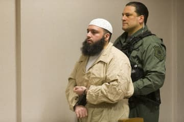 Chelsea Bomber Ahmad Khan Rahimi is lead into the courtroom for sentencing for the attempted murder of five policemen by Judge John Deitch at the Union County Courthouse in Elizabeth on Friday morning.  01/24/2020 (Steve Hockstein | For NJ Advance Media/)