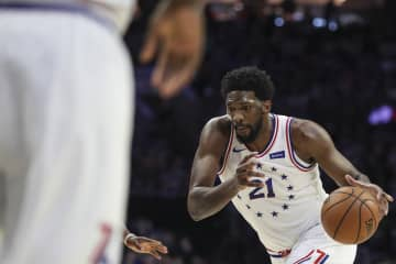 The Philadelphia 76ers' Joel Embiid dribbles against the Indiana Pacers on March 10, 2019. - HEATHER KHALIFA/The Philadelphia Inquirer/TNS