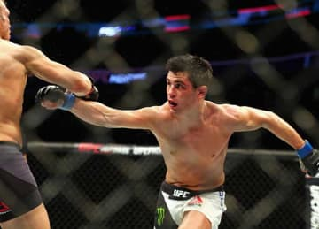 Dominick Cruz (R) attempts to punch T.J. Dillashaw in their bantamweight bout during UFC Fight Night 81 at TD Banknorth Garden on January 17, 2016 in Boston, Massachusetts.
