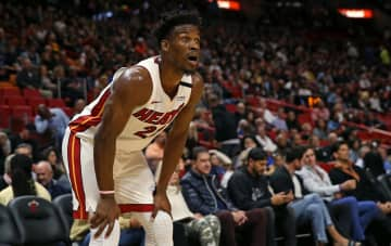 Miami Heat forward Jimmy Butler looks on during action against the Washington Wizards at the AmericanAirlines Arena in Miami on January 22, 2020. - DAVID SANTIAGO/Miami Herald/TNS