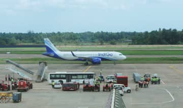 A plane is seen at the taxiway after landing at Kochi's International airport in the Indian state of Kerala on August 29, 2018.