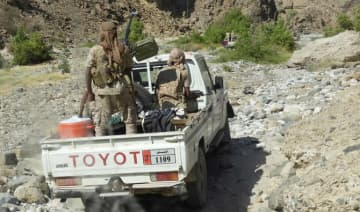Yemeni fighters loyal to the government backed by the Saudi-led coalition fighting in the country ride in the back of a pickup truck with mounted heavy machine gun in Hadramawt on February 21, 2018.
