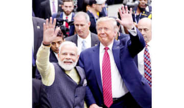 Indian Prime Minister Narendra Modi and US President Donald Trump wave to participants at a rally in Houston's NRG Stadium late last year.