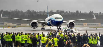Boeing employees and family members cheer the 777X after it landed at Boeing Field in Seattle, completing its first flight on Saturday, Jan. 25, 2020. - Mike Siegel/Seattle Times/TNS