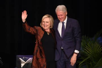 Hillary Clinton with a fellow Democrat who actually knew how to win elections. (Tanya Moutzalias | MLive.com/)